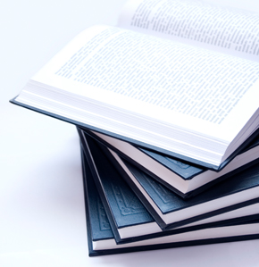 A stack of books that hold policies