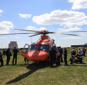 Attendees viewing Ornge's AW139 aircraft up close.