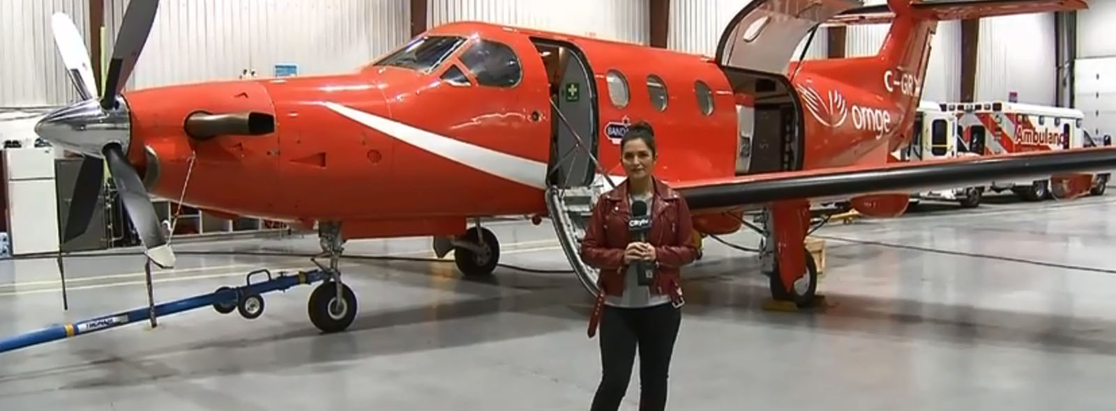 Stella Acquisto in front of fixed wing aircraft