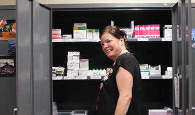 Catherine Dawes standing in front of medication