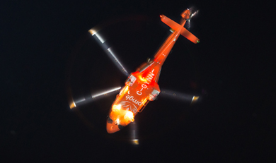 belly of ornge helicopter in night sky