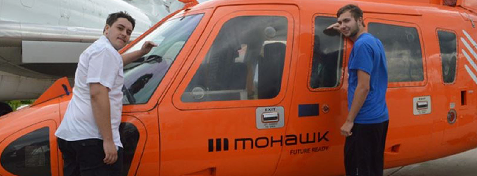 Mohawk College students in front of donated Sikorsky helicopter