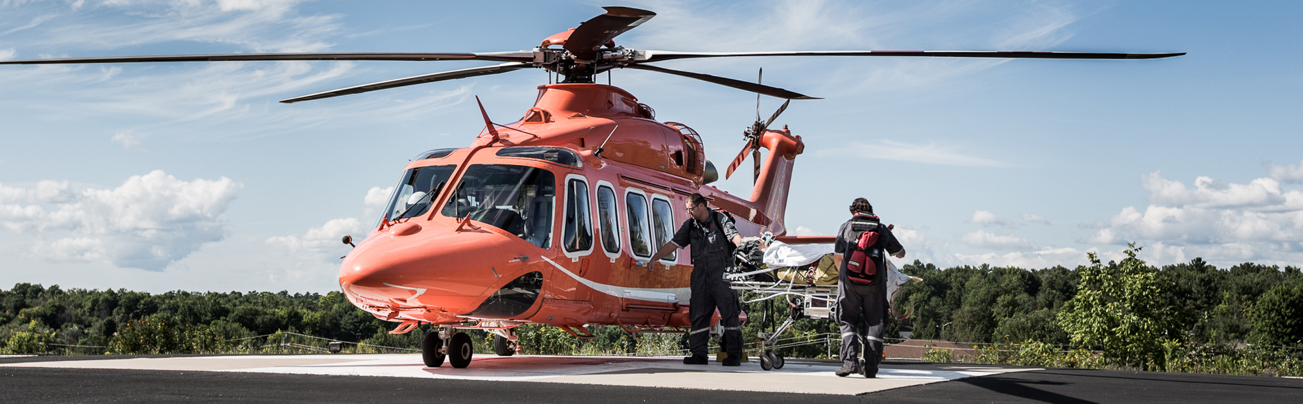 A group of paramedics waking towards an Ornge helicopter