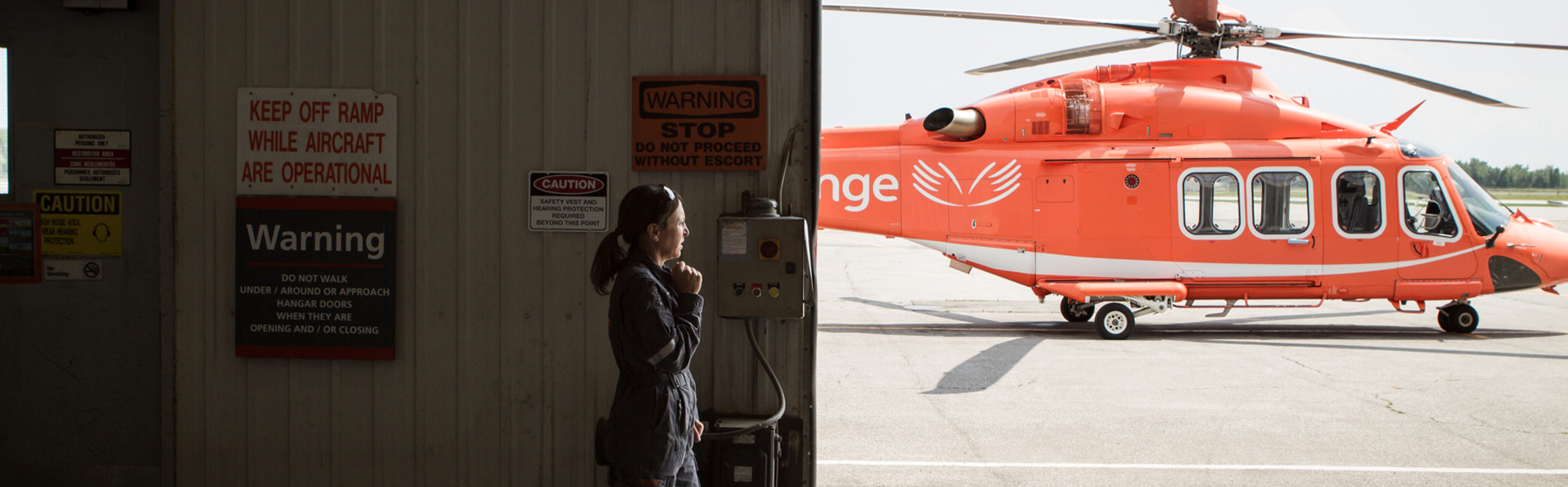 An Ornge employee talking with a headset on