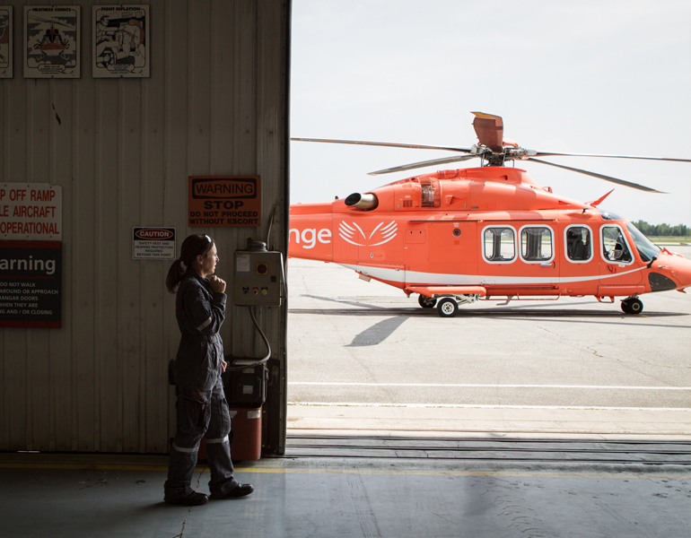 An image of an Ornge employee working in the corporate sector wearing a headset