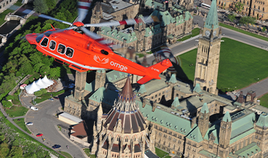 Ornge helicopter over Parliament